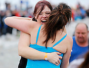 Chelsea Henry, left, hugs Randi Kirsch, both of Warsaw, at the 14th Annual Polar Bear Plunge at Ontario Beach Park on Sunday, February 9, 2014.