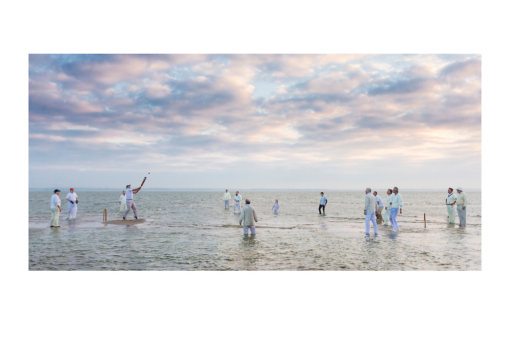 A fabulous action shot of the annual Brambles Bank cricket match in the Solent at sunrise. Tradition dating back to 1950s. Match between the Island Sailing Club, Cowes, Isle of Wight and the Royal Southern Yacht Club, Hamble, Hampshire, UK.   //   High quality prints are available from &pound;23, with a choice of sizes and finishes. Print dimensions match readily available frames. For larger prints, we recommend professional mounting and framing. Multiple prints of similar size share one delivery charge, and next day delivery is available on orders placed before 1pm. Christmas deadline - 22nd December 2016. Full money-back guarantee if you're not happy for any reason.   //   <br /> Unusual Cricket Photography by Christopher Ison &copy;<br /> 07544044177<br /> chris@christopherison.com<br /> www.christopherison.com