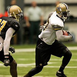 12 August 2009: New Orleans Saints wide receiver Adrian Arrington (87) runs after a catch as cornerback Malcolm Jenkins (27) pursues the play during New Orleans Saints training camp at the team's indoor practice facility in Metairie, Louisiana.