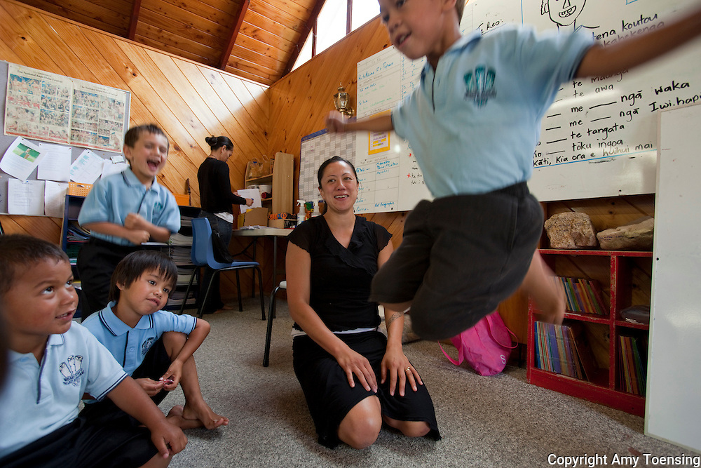 ROTORUA, NEW ZEALAND -- FEBRUARY 12: Te Wharekura o Ngati Rongomai, a Maori school designated to the children who have genealogical connections to this specific Marae and tribal land  - allowing them to learn on their own land and property. The school is funded by the crown government - just as the public schools...Many of these students came from mainstream schools and have had to learn Maori. They are all related and so it is like a big family. One girl told me, &quot;The thing I like about this school is no one ever gets bullied because it's only Whanua, or family. I feel safe here.&quot;..Ms. Curtis teaches language to the younger kids with song and movement. in the background is Phillipa Moore...Contact: .Tukiterangi Curtis, Principal.matarua@xtra.co.nz.+64 (0)7 3627 174.+64 (0)7 348 8528...Photo By Amy Toensing _________________________________<br />