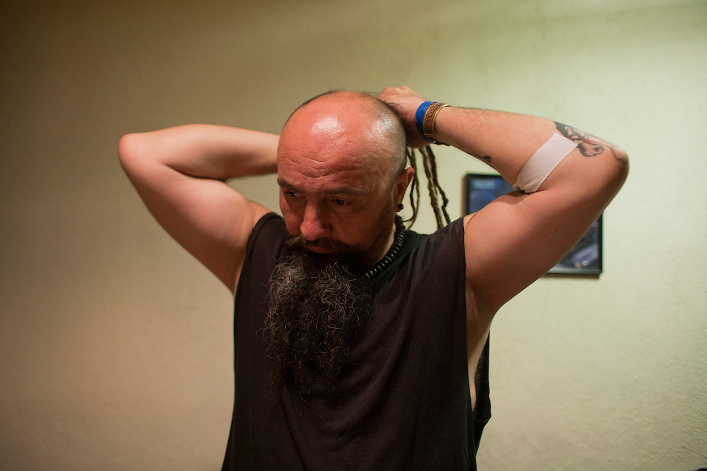 "Srdjan ""Gino"" Jevdjevic prepares backstage at Gun Club in Belgrade, Serbia..."