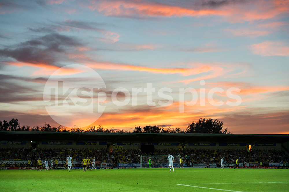 The sun sets over the Pirelli Stadium during the EFL Sky Bet Championship match between Burton Albion and Derby County at the Pirelli Stadium, Burton upon Trent, England on 26 August 2016. Photo by Brandon Griffiths.