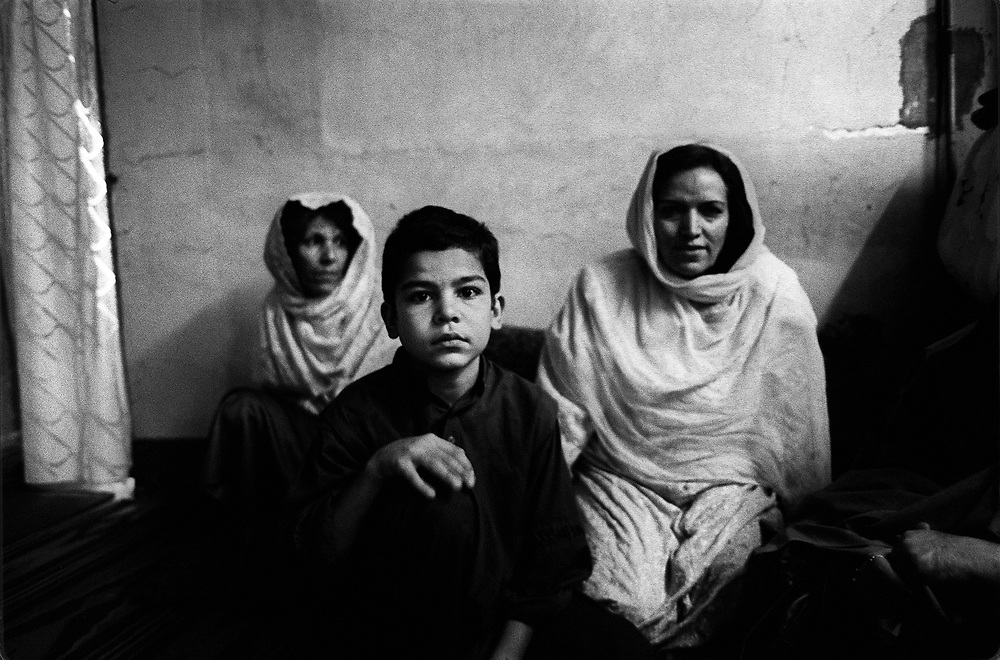 Refugees from Afghanistan living in Peshawar, Pakistan. 2000.  Many Afghanies had left their home country due to a continuous state of civil war and foreign occupations.   The Taliban that governed Afghanistan in the late 90s and enforced strict rules especially for women also contributed to many people leaving the country.