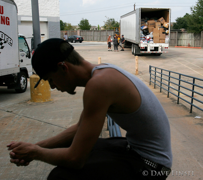 PASADENA - SEPTEMBER 8:  Matt Skyberg hangs his head as he says, &quot;How could it end up like this?&quot; at a Salvation Army donation center in Pasadena,TX, Thursday, September 8, 2005. A group of tattoo artists drove in five trucks from Lake Elsinore to Houston with donated goods for evacuees of Hurricane Katrina. They were turned away from the Reliant Complex and forced to find other groups to take their donation.<br />