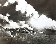 Photograph of the night-time bombing of an ammunition dump near Sable-sur-Sarthe, Pays de la Loire, France, by RAF Lancaster bombers, 6th May 1944, during the Second World War. Huge balls of fire and flying wreckage from this direct hit resulted in constant explosions, with sheets of fire enveloping the buildings, which could still be seen by the bombers while returning home across the English Channel. Picture by Manuel Cohen