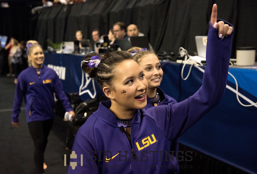 21 APRIL 2018 -- ST. LOUIS -- LSU gymnast Sarah Finnegan acknowledges the Tiger's fans during introductions during the opening of the 2018 NCAA Women's Gymnastics Championship Super Six at Chaifetz Arena in St. Louis Saturday, April 21, 2018.<br /> Photo &copy; copyright 2018 Sid Hastings.
