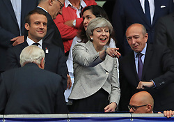 French President Emmanuel Macron (left) and Prime Minister of the United Kingdom Theresa May in the crowd