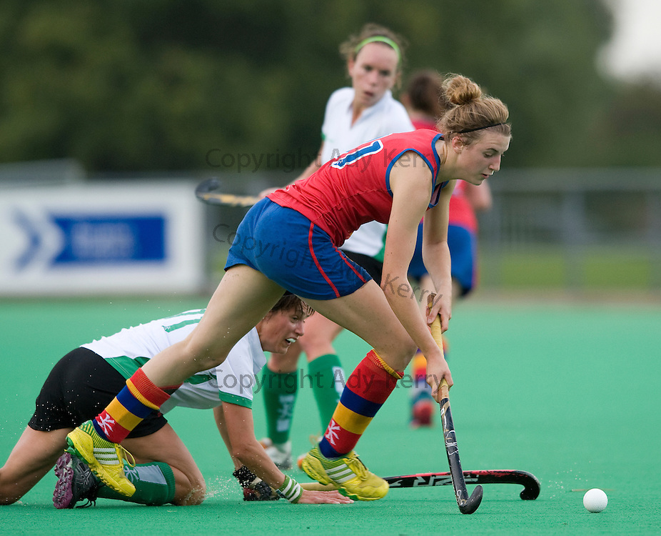 University of Birmingham's Lily Owsley gets away from Canterbury's Nikki Triggs during their Investec Women's Hockey League Premier Division game at Polo Farm, Canterbury, Kent, 21st September 2013.