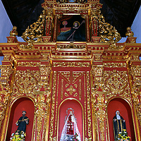 Convent de la Popa Altar in Cartagena, Colombia<br /> In the center of the gilded altar at El Convento de la Popa is the image of La Virgin de la Candelaria.  She is shown as a Black Madonna holding a dark skinned baby Jesus and a candle in her other hand. The image is patterned after a statue appearing on a beach in 1594 in Tenerife, one of the Canary Islands. This shrine was visited by Pope John Paul II in 1986. An annual pilgrimage is held on February 2, the feast day of the Virgin of Candelaria.