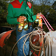 SAN CARLOS, PANAMA - FEBRUARY 11: On a scrotching midafternoon, a Cowboy brings beer to his teamates during a lasso competition in San Carlos, near Boquete, Panama, on February 11, 2007. In the competition, each heat features one town's team versus another in a tournament bracket style. The speed of the calf's capture determines points.  (Photo by Logan Mock-Bunting)