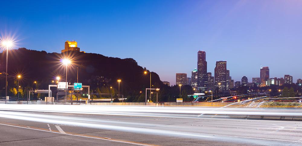 Interstate 90 and city skyline at night, Seattle, Washington State, USA
