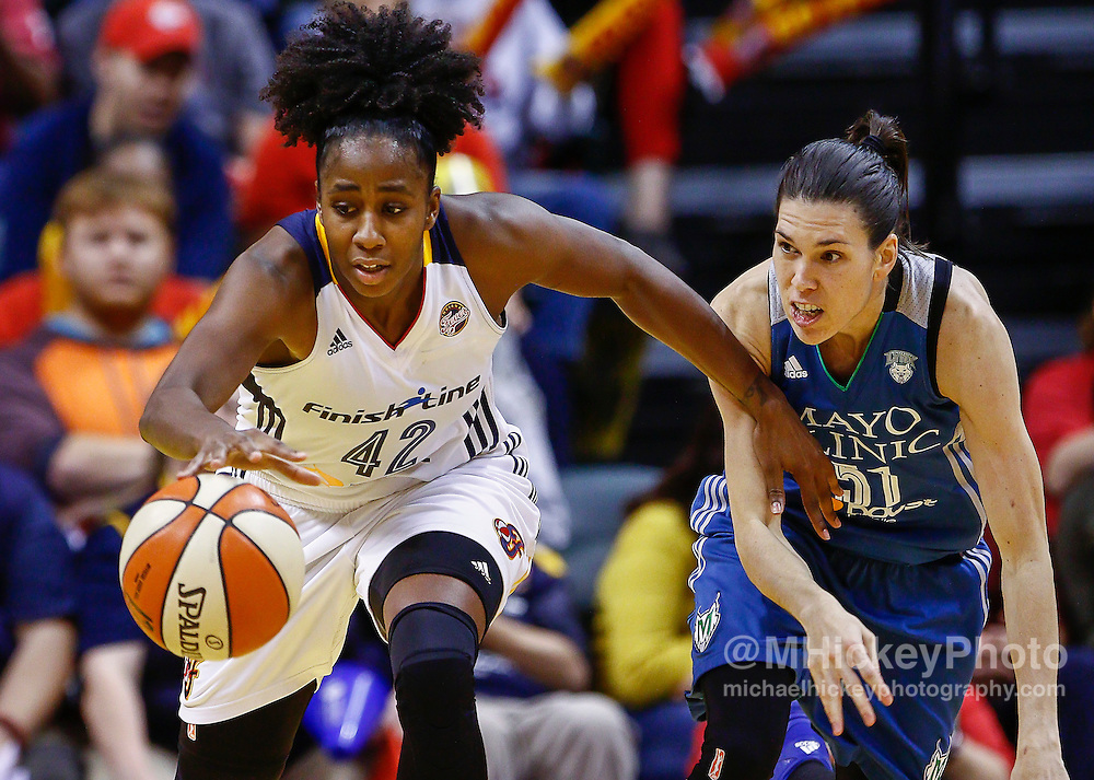 INDIANAPOLIS, IN - OCTOBER 11: Shenise Johnson #42 of the Indiana Fever and Anna Cruz #51 of the Minnesota Lynx chase down a loose ball at Bankers Life Fieldhouse on October 11, 2015 in Indianapolis, Indiana. Indiana defeated Minnesota 75-69. NOTE TO USER: User expressly acknowledges and agrees that, by downloading and or using this photograph, User is consenting to the terms and conditions of the Getty Images License Agreement. (Photo by Michael Hickey/ Getty Images) *** Local Caption *** Shenise Johnson; Anna Cruz