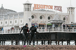 © Licensed to London News Pictures. 30/11/2014. Brighton, UK. Members of the Brighton Sea Swimmers club return from the daily swim in the sea. The temperatures are expected to reach a maximum of 10C in Brighton and down the South Coast. Photo credit : Hugo Michiels/LNP