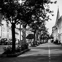 Kveldstemning i Kristiansand.<br /> En person g&aring;r nedover gaten i kveldslyset en augustkveld. Fotografert med et Fujifilm 56mm 1.2 objektiv.<br /> <br /> Evening in Kristiansand. A person walking along in the evening. Photographed used Fujifilm X-E2 and 56mm 1.2 optics.