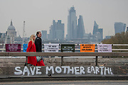 Things quieten down as evening arrives and commuters head home over the newly adapted 'garden' Waterloo Bridge - Protestors from Extinction Rebellion block several (Hyde Park, Oxford Cuircus, Warterloo Bridge and Parliament Square) junctions in London as part of their ongoing protest to demand action by the UK Government on the 'climate chrisis'. The action is part of an international co-ordinated protest.