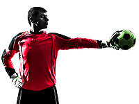 one  soccer player goalkeeper man standing stopping ball with one hand in silhouette isolated white background