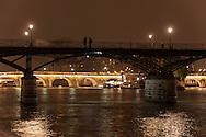 France. Paris. 1st district Art bridge on the Seine river at dusk view from the quai du Louvre in the distance the pont Neuf / le pont des arts sur la Seine