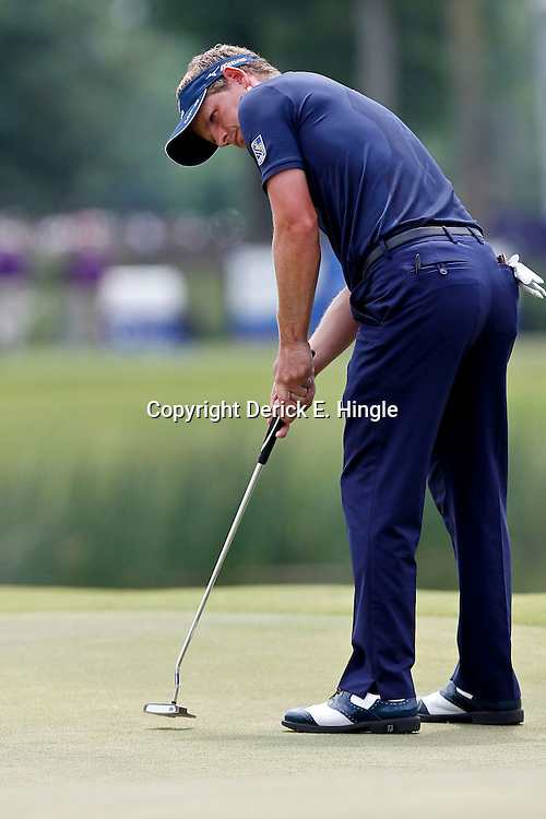 Apr 29, 2012; Avondale, LA, USA; Luke Donald putts on the ninth hole during the final round of the Zurich Classic of New Orleans at TPC Louisiana. Mandatory Credit: Derick E. Hingle-US PRESSWIRE