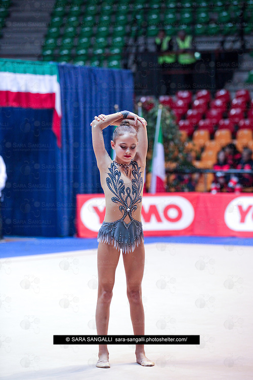 DESIO, ITALY - OCTOBER 31 2015: Nina Corradini of Lazio Ginnastica Flaminio performs freehand at the italian national rhythmic gymnastic championship. Her score in the apparatus is 14,450. Her team's score is 87,250 and ended up in second position.