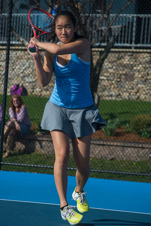 4/1/16 - Medford/Somerville, MA - Tomo Iwasaki hits the ball during the Tufts women's tennis matches against Colby on the Voute Tennis Courts on Apr 1, 2016. (Ray Bernoff / The Tufts Daily)