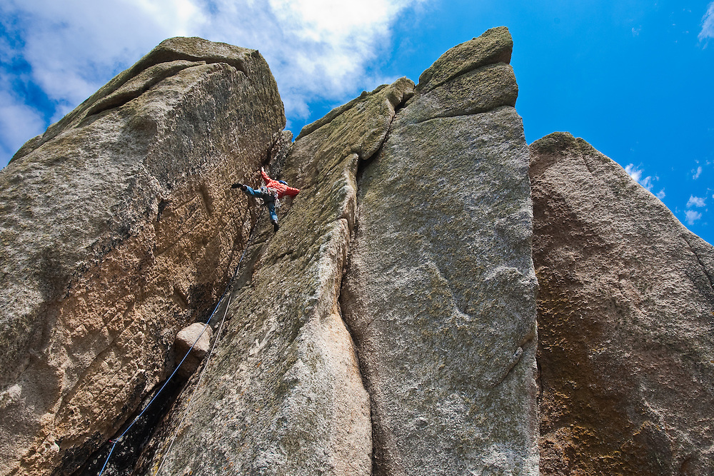 Mark Glaister climbing 'Kernyck' hard severe 4b at Cribba Head, Cornwall, England