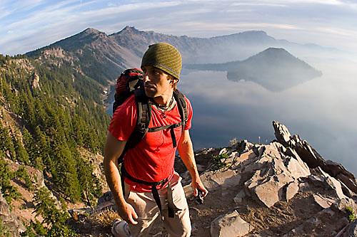 Young man hiking at Crater Lake National Park, Oregon<br />