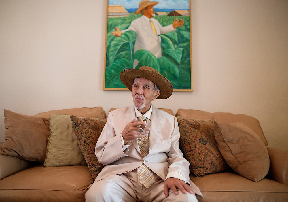 Avo Uvezian, 89, renowned cigar maker, smokes one of his Avo cigars at his Orlando home on on December 18, 2015. In addition to his fine cigars, Uvezian studied at The Juilliard School, is a musician and composer and speaks 9 languages. (Jacob Langston for the New York Times)