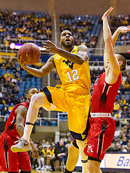 Dec 10, 2016; Morgantown, WV, USA; West Virginia Mountaineers guard Tarik Phillip (12) shoots in the lane during the first half at WVU Coliseum. Mandatory Credit: Ben Queen-USA TODAY Sports