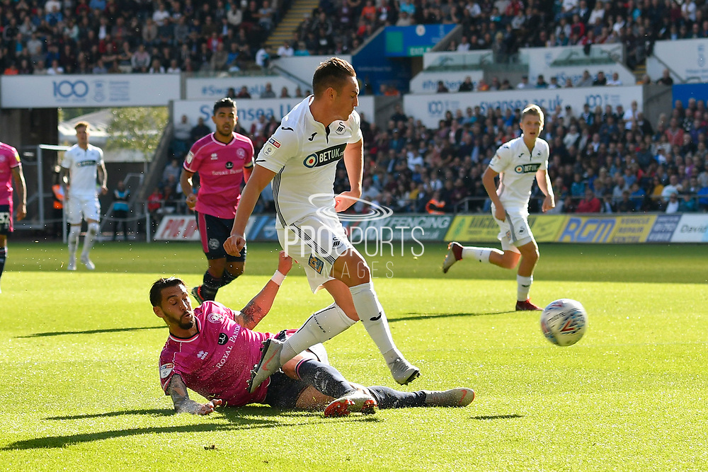Connor Roberts (23) of Swansea City shoots at goal during the EFL Sky Bet Championship match between Swansea City and Queens Park Rangers at the Liberty Stadium, Swansea, Wales on 29 September 2018.