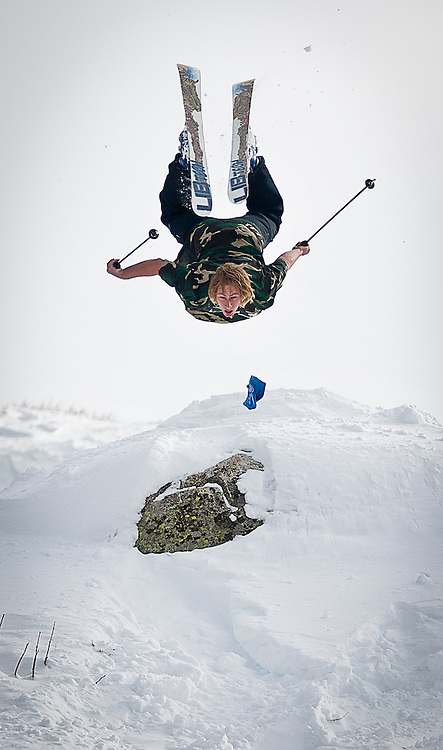 Skier Tyler Pirruccio goes for a backflip off of a jump at the Brighton Ski Resort, opening on November 13th for the season, Monday, Nov. 12, 2012.