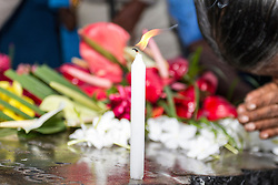 © Licensed to London News Pictures. 26/12/2014. Sri Lanka, UK 10th year commemorations of the Indian Ocean Tsunami, in Sri Lanka. Here in Peraliya, Buddhist devotees make offerings at the Tsunami memorial, in remembrance of the 1500 people that lost their lives on the fated Tsunami Train that derailed nearby,  and to the untold victims nationwide, estimated to be 40,000 people. Photo credit : Sam Spickett/LNP