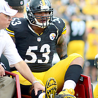 Pittsburgh Steelers center Maurkice Pouncey (53) leaves the field as a Steelers trainer hold his knee in first quarter against the Tennessee Titans at Heinz Field in Pittsburgh on September 8, 2013.  UPI/Archie Carpenter