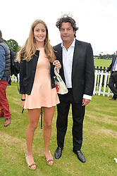 NATASHA MOUFARRIGE and her father TIM MOUFARRIGE at the Cartier Queen's Cup Final polo held at Guards Polo Club, Smith's Lawn, Windsor Great Park, Egham, Surrey on 15th June 2014.