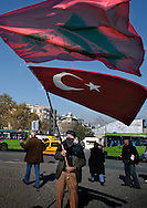 ISTANBUL, TURKEY - 22-11-2003: Man selling Turkish flags at Taksim square in Istanbul a few days after the bombings on the British Embassy and the HSB bank on November 20. The bombings have stronged the feelings of nationalism amongst the Turkish citizens.