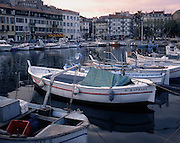 AA00370-01...FRANCE - Fishing boats in the Cannes Harbor, part of the French Riviera.