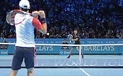 Serbia's Novak Djokovic returning a shot from Japan's Kei Nishikori during the Semi Final of Barclays ATP World Tour 2014 between Serbia's Novak Djokovic and Japan's Kei Nishikori, O2 Arena, London, United Kingdom on 15th November 2014 © Pro Sports Images