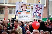 Frankfurt am Main | 21.09.2013<br /> <br /> Endspurt-Kundgebung auf dem Frankfurter R&ouml;merberg zum Landtagswahlkampf der SPD (Sozialdemokratische Partei Deutschlands) 2013, hier: Merkel- und Putin-kritische Plakate.<br /> <br /> ABDRUCK/NUTZUNG HONORARPFLICHTIG!<br /> <br /> &copy;peter-juelich.com<br /> <br /> [No Model Release | No Property Release]