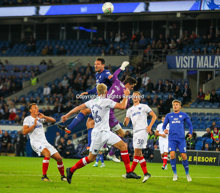 August 8th 2017, Cardiff City Stadium, Cardiff, Wales; Carabao Cup First Round; Cardiff City versus Portsmouth; Sean Morrison of Cardiff City and Luke McGee of Portsmouth challenge for the ball