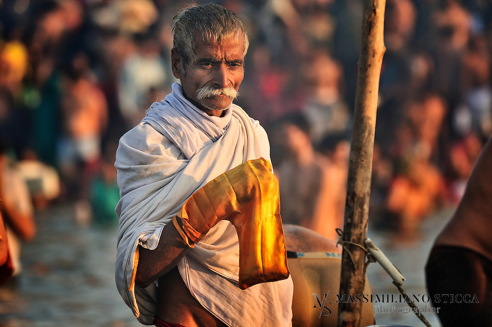 A Hindu devotee prays in the river close to the banks of Sangam..