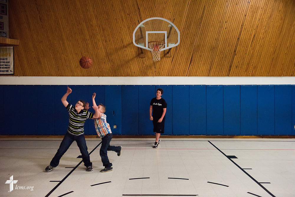 Viktor and Sergei Fritsche play a game of pickup basketball with school friends during a visit to their former congregation, Zion Lutheran Church and School, Staunton, Ill., during home service on Wednesday, April 26, 2017, in Staunton.  LCMS Communications/Erik M. Lunsford