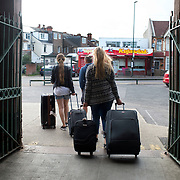 Bognor Regis, Sussex. Young Eastern European women with suitcases leave the station