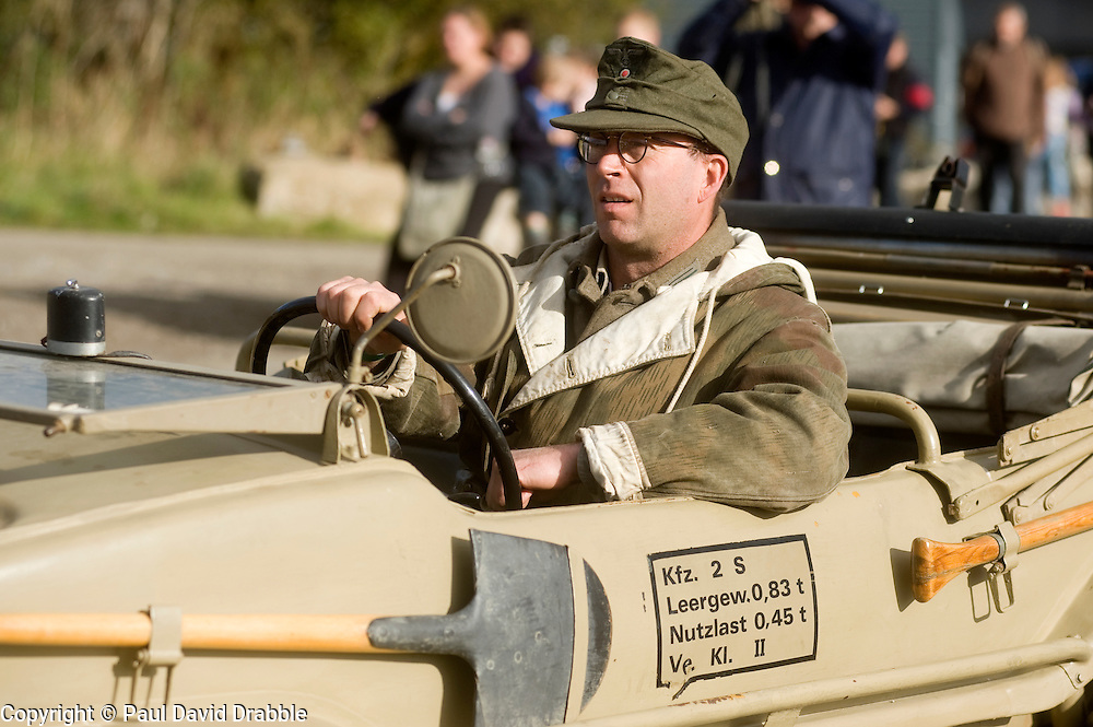 Pickering 1940s war weekend. A reenactor from the 21st Panzer Living History Group driving a Schwimmwagen Type 166 October 2009 Image Copyright Paul David Drabble