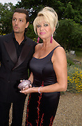 Ivana Trump and Rossano Rubicondi, Some Enchanted evening, in aid of the Galapagos conservation society.  Chelsea Physic Garden, 17 June 2004. ONE TIME USE ONLY - DO NOT ARCHIVE  © Copyright Photograph by Dafydd Jones 66 Stockwell Park Rd. London SW9 0DA Tel 020 7733 0108 www.dafjones.com