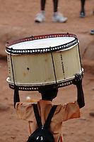 Ghana, Accra, Kokomlemle, 2007. An elementary school student brings his drum to a school assembly marking Independence Day.
