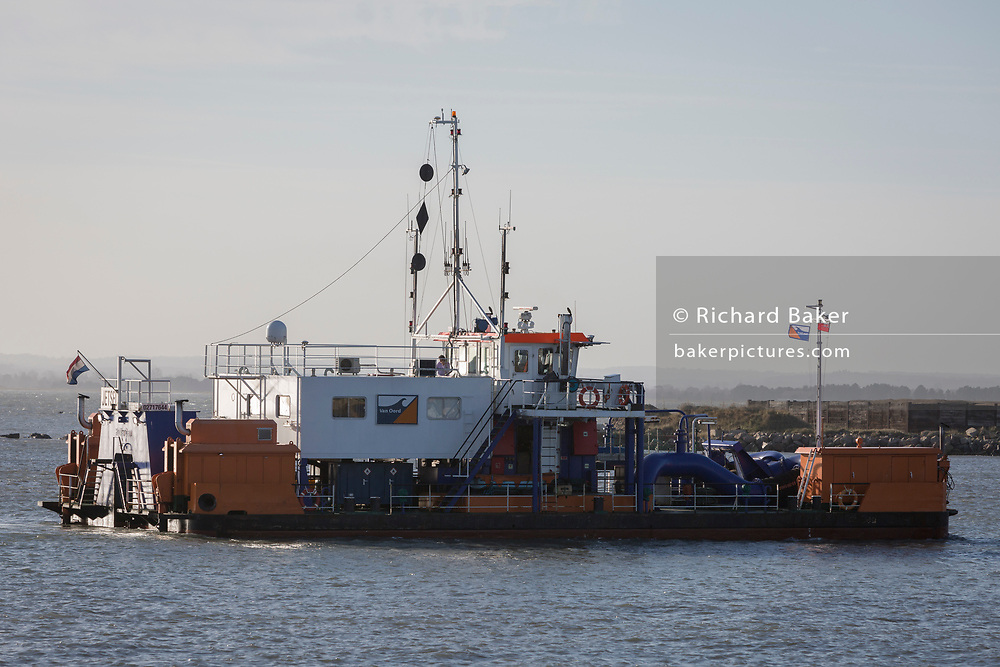A Dutch-registered dredger works in waters of the Port of Ramsgate, a closed but once busy ferry terminal, on 8th January 2019, in Ramsgate, Kent, England. The Port of Ramsgate has been identified as a 'Brexit Port' by the government of Prime Minister Theresa May, currently negotiating the UK's exit from the EU. Britain's Department of Transport has awarded to an unproven shipping company, Seaborne Freight, to provide run roll-on roll-off ferry services to the road haulage industry between Ostend and the Kent port - in the event of more likely No Deal Brexit. In the EU referendum of 2016, people in Kent voted strongly in favour of leaving the European Union with 59% voting to leave and 41% to remain.