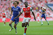 Arsenal's Danny Welbeck(23) and Chelsea's David Luiz(30)  during the The FA Cup final match between Arsenal and Chelsea at Wembley Stadium, London, England on 27 May 2017. Photo by Shane Healey.