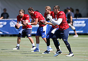 Four Los Angeles Rams quarterbacks run and passing drill during the Los Angeles Rams 2016 NFL training camp football practice held on Tuesday, Aug. 2, 2016 in Irvine, Calif. (©Paul Anthony Spinelli)
