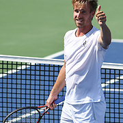 PETER GOJOWCZYK reacts after winning at the Rock Creek Tennis Center.
