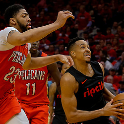 Apr 19, 2018; New Orleans, LA, USA; Portland Trail Blazers guard CJ McCollum (3) drives past New Orleans Pelicans forward Anthony Davis (23) during the second half in game three of the first round of the 2018 NBA Playoffs at the Smoothie King Center. The Pelicans defeated the Trail Blazers 119-102.  Mandatory Credit: Derick E. Hingle-USA TODAY Sports