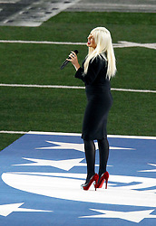 Feb 6, 2011; Arlington, TX, USA; Recording artist Christina Aguilera performs the national anthem before Super Bowl XLV between the Green Bay Packers and the Pittsburgh Steelers at Cowboys Stadium.  Green Bay defeated Pittsburgh 31-25.